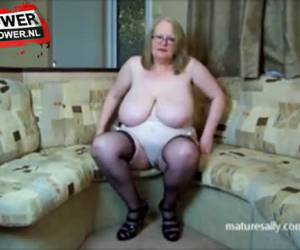 Mature bitch plays whiteh her big tits